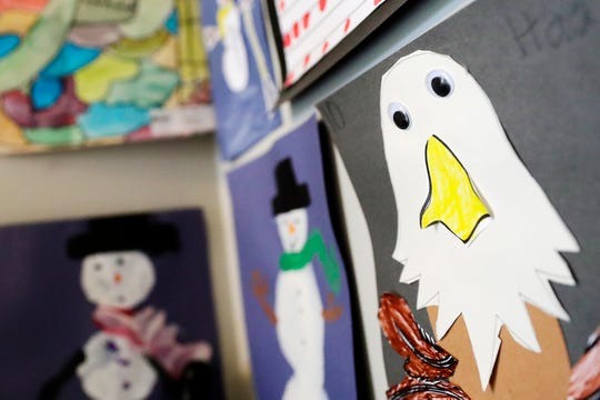 Kids art is displayed in the home of foster parent Katie Szerkins on Tuesday, April 30, 2019 in Howard, Wis.