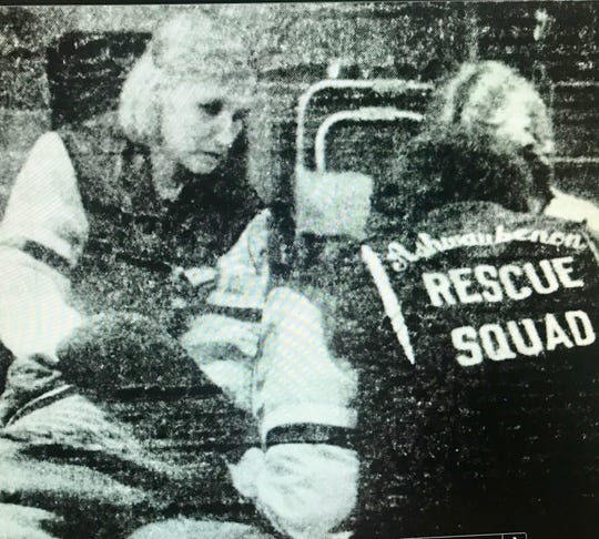 Ashwauben Rescue Squad personnel tend to a concertgoer who passed out at the Black Sabbath concert in 1982 at Brown County Veterans Memorial Arena.