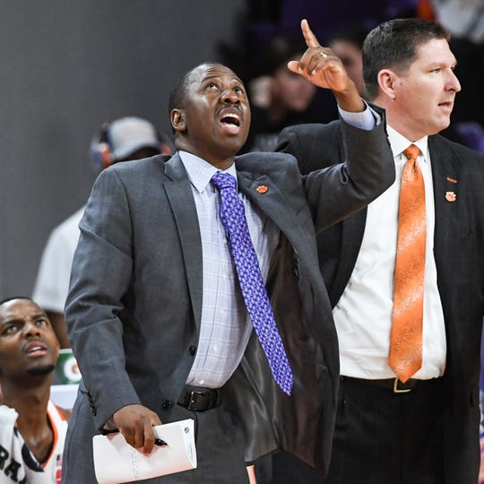 Steve Smith, left, an assistant for Clemson men's basketball team near head coach Brad Brownell, right, during the game in February 2019.