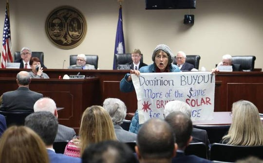 Protestors briefly interrupted a meeting in December 2018 of the S.C. Public Service Commission before the commission voted to set SCE&G's electric rates moving forward and to approve Dominion Energy's offer to buy SCE&G's parent company, SCANA