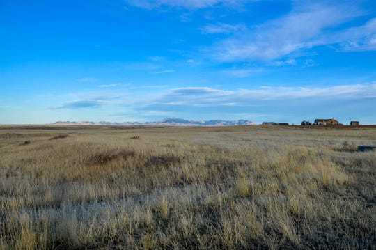 View of the Highwood Mountains and homes southeast of Great Falls. The proposed site of Big Sky Cheese.