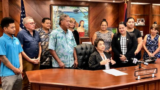 Gov. Lou Leon Guerrero says Guam as a pathogen-free area could become the shrimp aquaculture capital of the Pacific, during a brief ceremony April 30, 2019 at Adelup on the governor's signing of an executive order creating the Guam Aquaculture Task Force. The governor is surrounded by task force members.