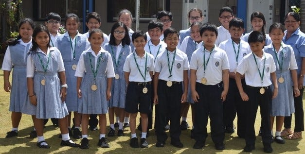 "Congratulations to Saint Anthony Catholic School 4th grade students who have garnered 3rd place in the CHamorro Language Competition ""Lina'la', Guinaya ya Pas"" at the Calvo's Fieldhouse on March 12, 2019. Pictured:  1st row: L-R: Jaycinth Aleonor, A'ani Shiroma, Kyle Hipolito, Hilary Toves, Alexander Cruz, and Kevin Thai.  2nd row: Alexia Tajalle, Kailey Quichcho, Julia McMurray, Ezekiel Dondoyano, Geralyn Mendiola, Matt Dio, and Yunji Oh. 3rd row: Marc Tolentino, Jarrett Ko, Zena Jun, Fuchollo Garcia, Shai-Ann Fair, Antonio Egurrola, Guinaya San Nicolas and Mrs. Rosa Rodriguez, Teacher."