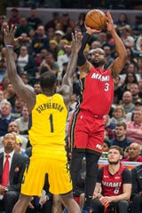 Mar 25, 2018; Indianapolis, IN, USA;  Miami Heat guard Dwyane Wade (3) shoots the ball over Indiana Pacers guard Lance Stephenson (1) in the first half against the Miami Heat at Bankers Life Fieldhouse. Mandatory Credit: Trevor Ruszkowski-USA TODAY Sports