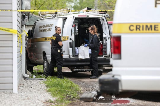 Investigators from IMPD and University of Indianapolis search the home of 8-month-old Amiah Robertson's babysitter in the 200 block of South Holmes Avenue in Indianapolis, Tuesday, April 30, 2019, where Robertson was last seen more than a month ago. After searching the property Monday and Tuesday, officials say nothing was found.