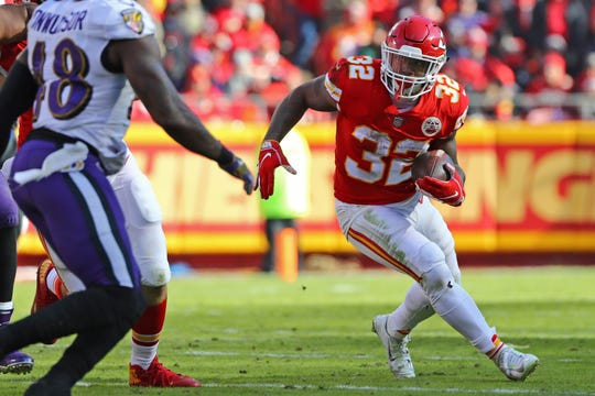 Dec 9, 2018; Kansas City, MO, USA; Kansas City Chiefs running back Spencer Ware (32) runs against the Baltimore Ravens in the first half at Arrowhead Stadium. Mandatory Credit: Jay Biggerstaff-USA TODAY Sports