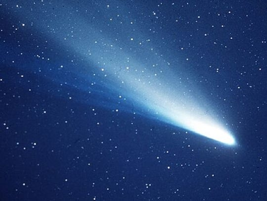Halley'e Comet swings by the Earth only once every 75 or 76 years, but dust it has left behind crosses our paths several times a year.