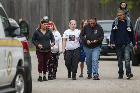 Family and friends stand by as investigators from IMPD and University of Indianapolis search the home of 8-month-old Amiah Robertson's babysitter in the 200 block of South Holmes Avenue in Indianapolis, Tuesday, April 30, 2019, where Robertson was last seen more than a month ago. After searching the property Monday and Tuesday, officials say nothing was found.
