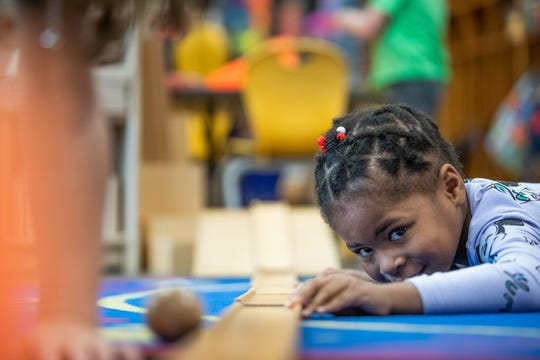 Tori Wilburn, 5, watches as a ball rolls down a series of connected wooden blocks inside Allison Kempers' pre-kindergarten classroom on Thursday, April 18, 2019. Wayne Township Preschool is an On My Way Pre-K program.