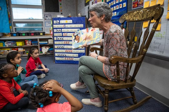 McClelland Elementary School kindergarten teacher Robin Johnson reads 'The Chicken-Chasing Queen of Lamar County' to her class on Thursday, April 18, 2019.