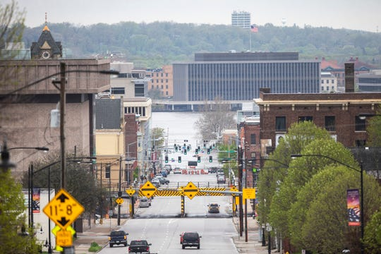 Flood waters from the Mississippi River covers Harrison Street, Tuesday, April 30, 2019, in downtown Davenport, Iowa.