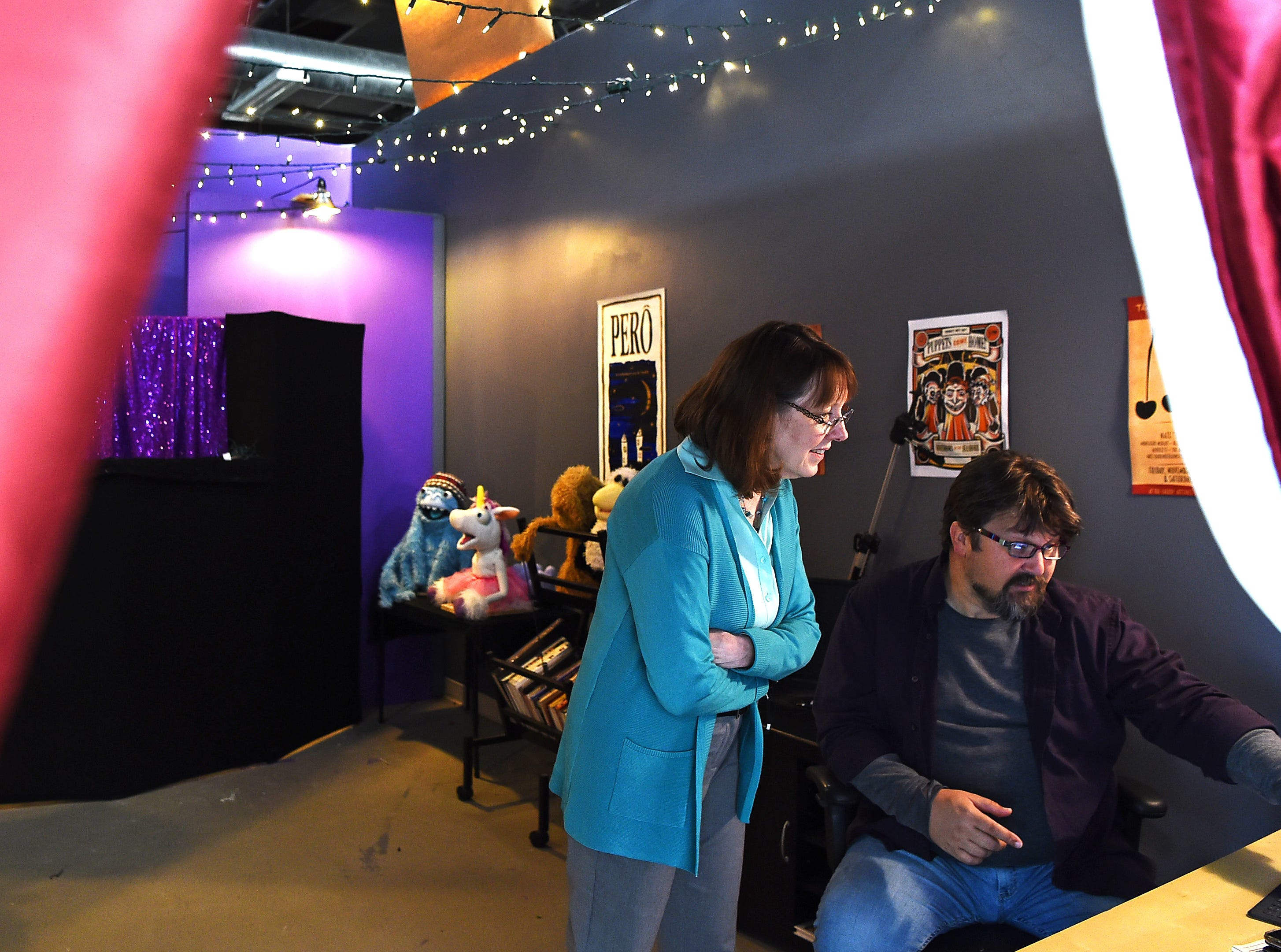 South Hill Business Complex manager Linda Luciano visits Scott Hitz in his Artist Alley studio PuttHitz. Hitz, a puppeteer, rents studio space in the former Danby Road industrial space that has been transformed into artist studios.