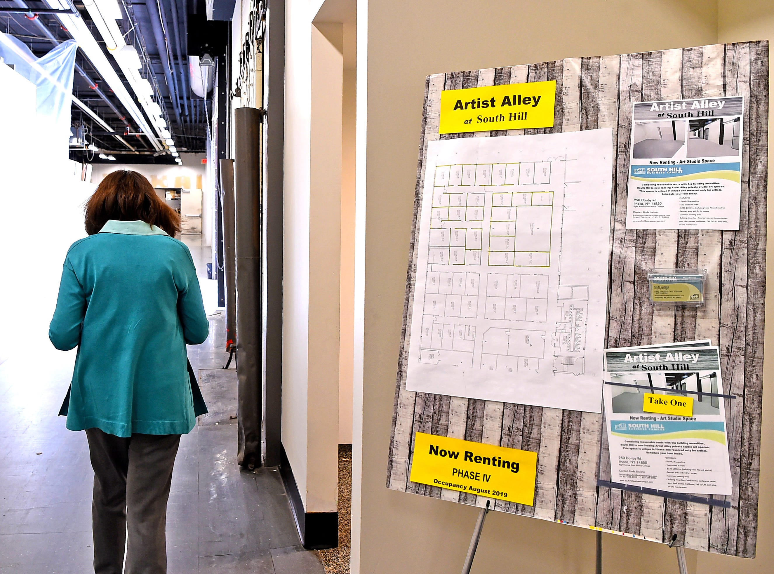 Linda Luciano, property manager of South Hill Business Complex on Danby Road in Ithaca, walks down the hallway leading to Artist Alley on the building's ground floor. Luciano has worked closely with several artists to learn what artists need in a workspace.
