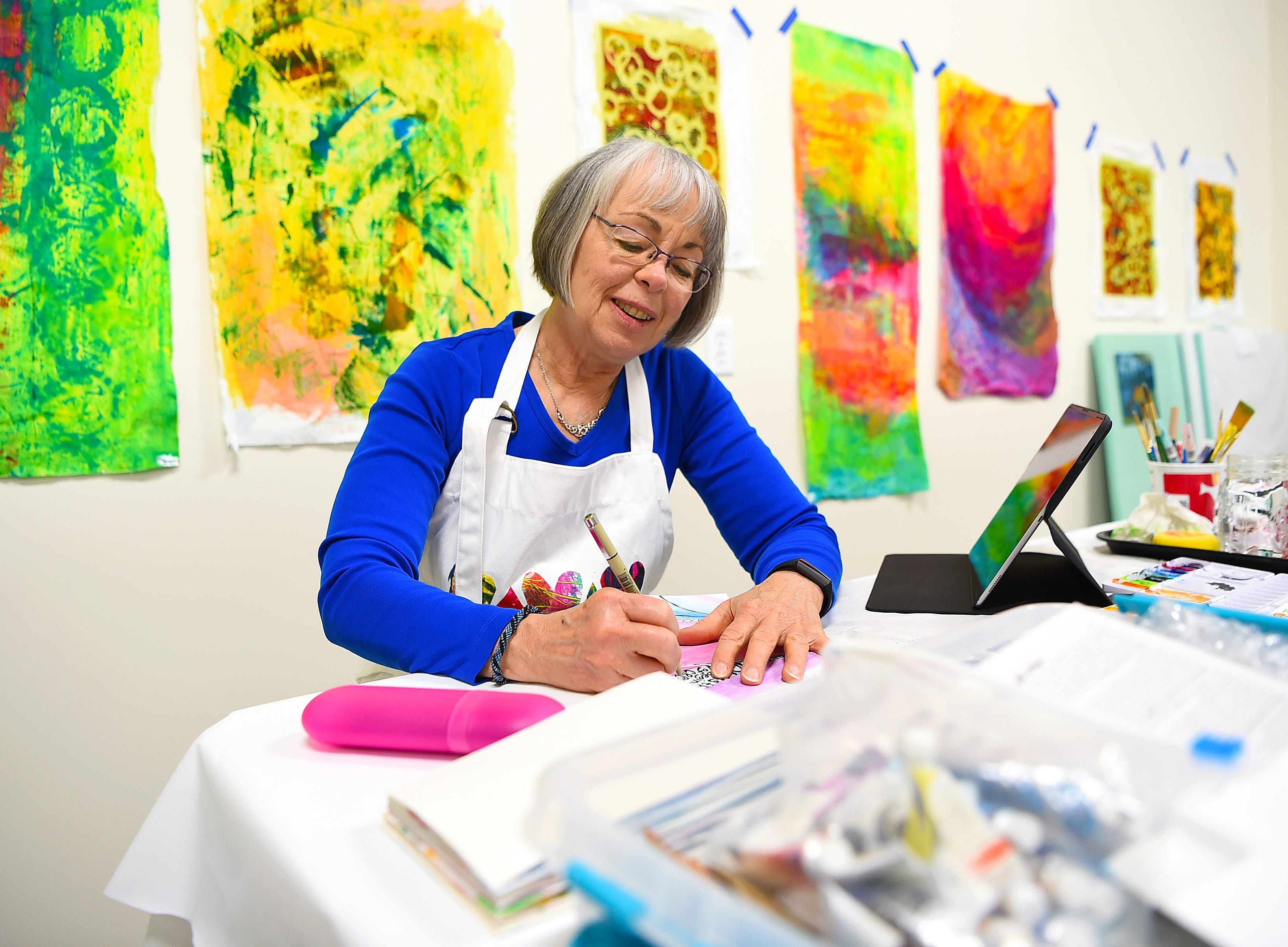 Carol LaBorie at work in her studio, Curiosity Works, which is located in Artist's Alley at South Hill. Once a large industrial space in the South Hill Business Complex on Danby Road, Artist's Alley has recently been transformed into a growing hub of art studios.
