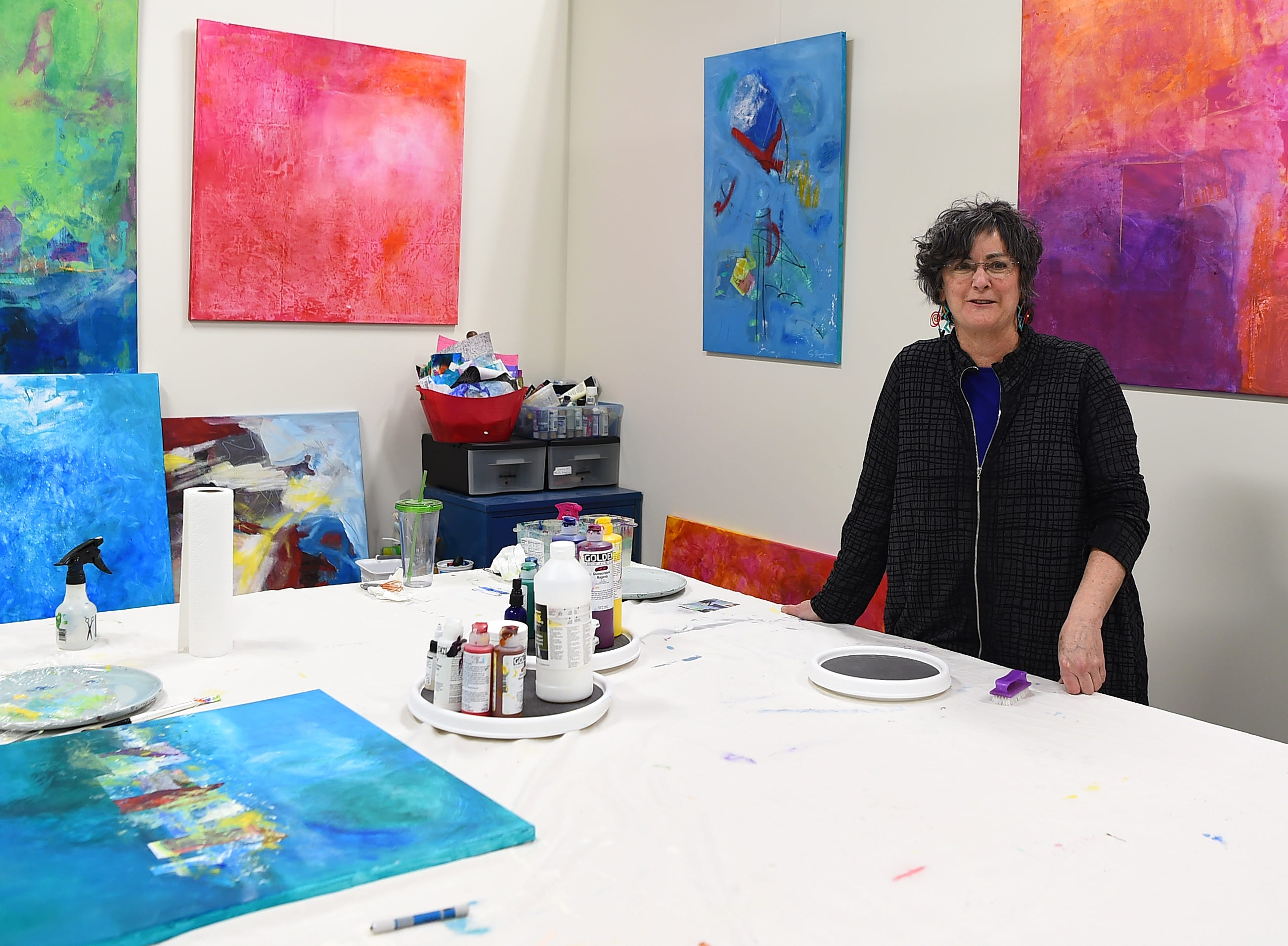 Sally Ryan in her Artist Alley studio. Located on Danby Road in Ithaca, Artist's Alley at South Hill houses a variety of art studios in what was once an industrial space.