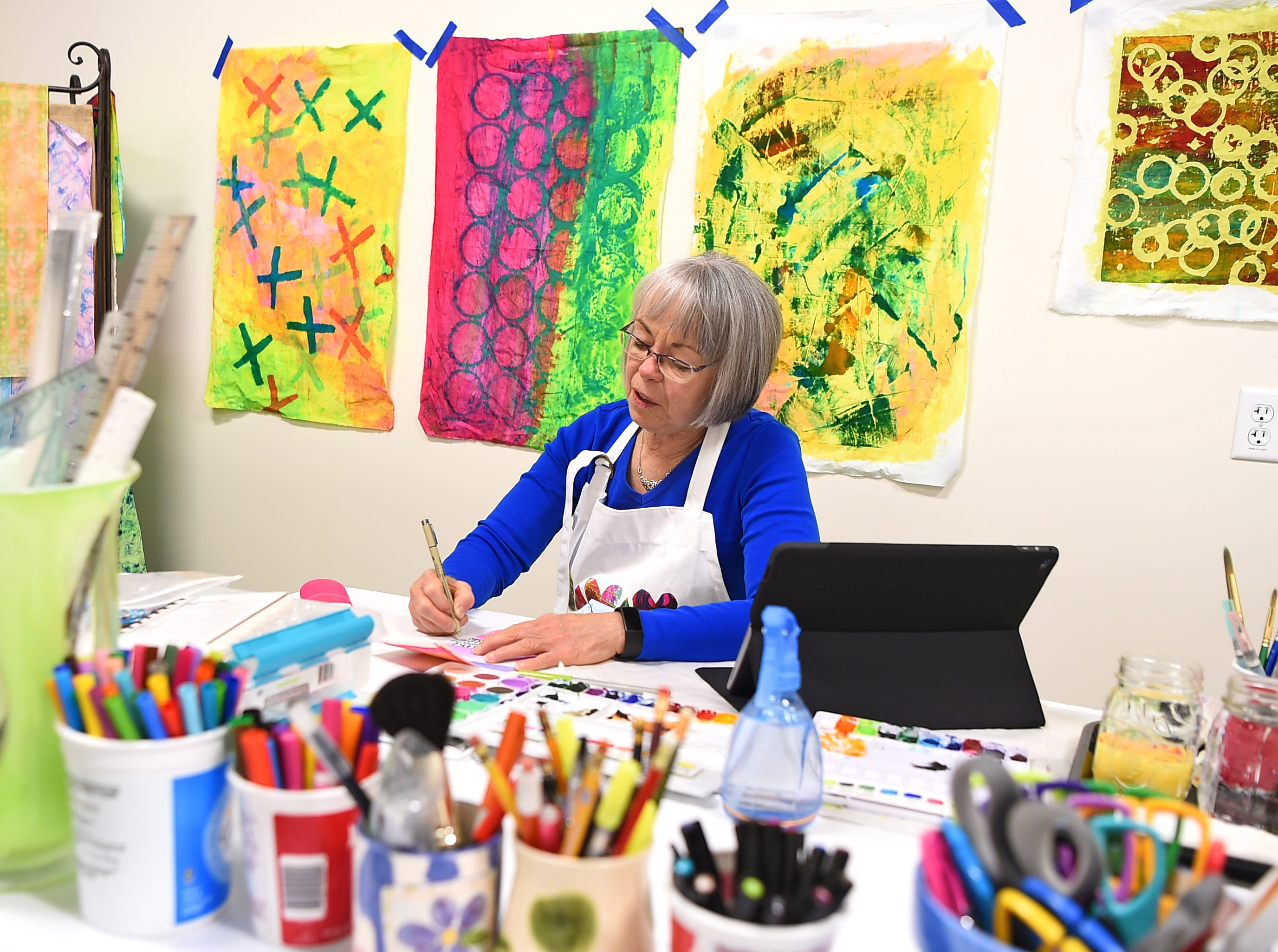 Carol LaBorie at work in her studio, Curiosity Works, which is located in Artist Alley at South Hill. LaBorie works in a variety of media, including fabric, paint and metals.