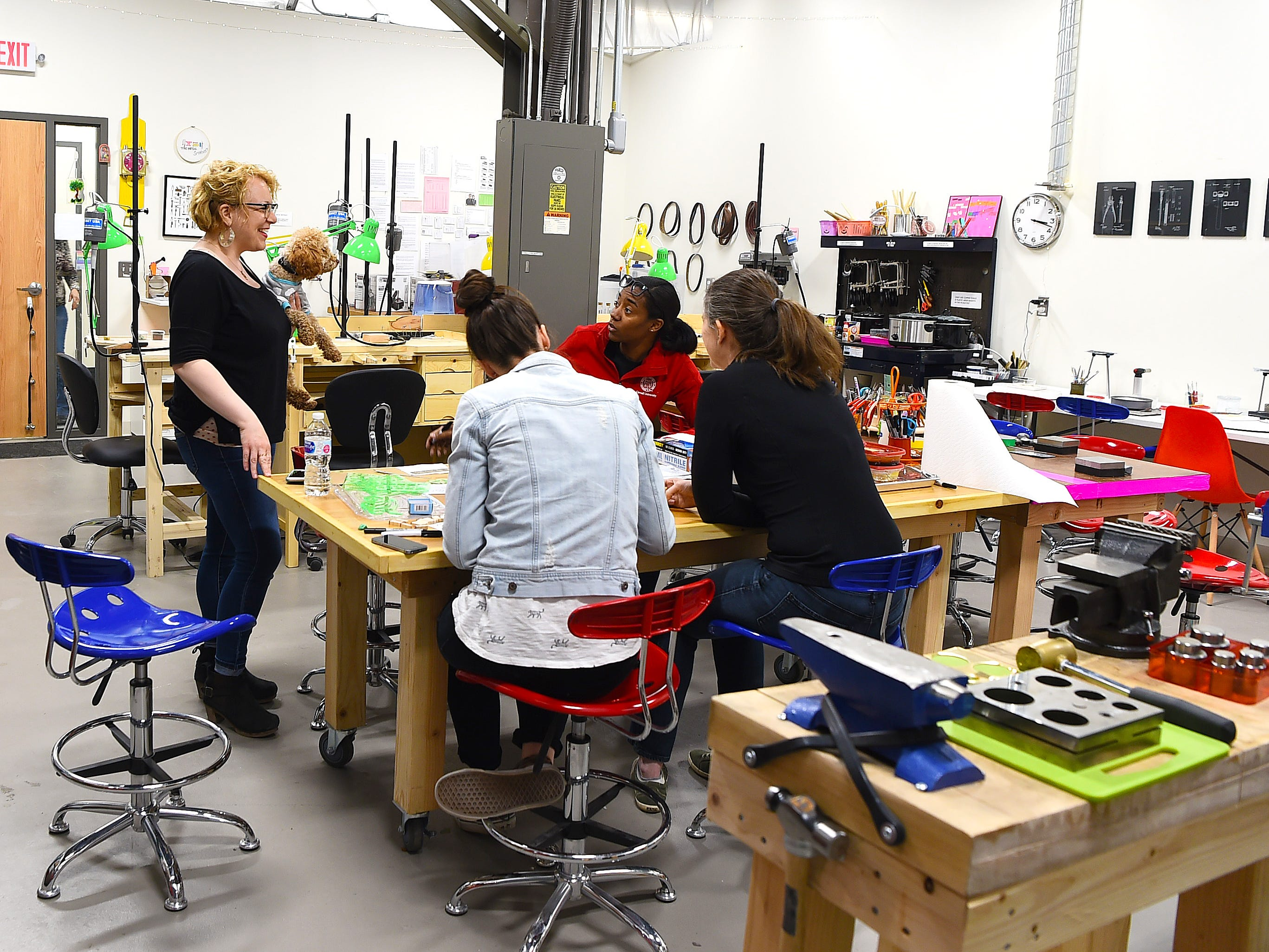 Elaan Greenfield talks with students at The Metal Smithery in the South Hill Business Campus on Danby Road. Once an industrial space, Artist Alley at South Hill now houses a variety of working art studios and businesses.