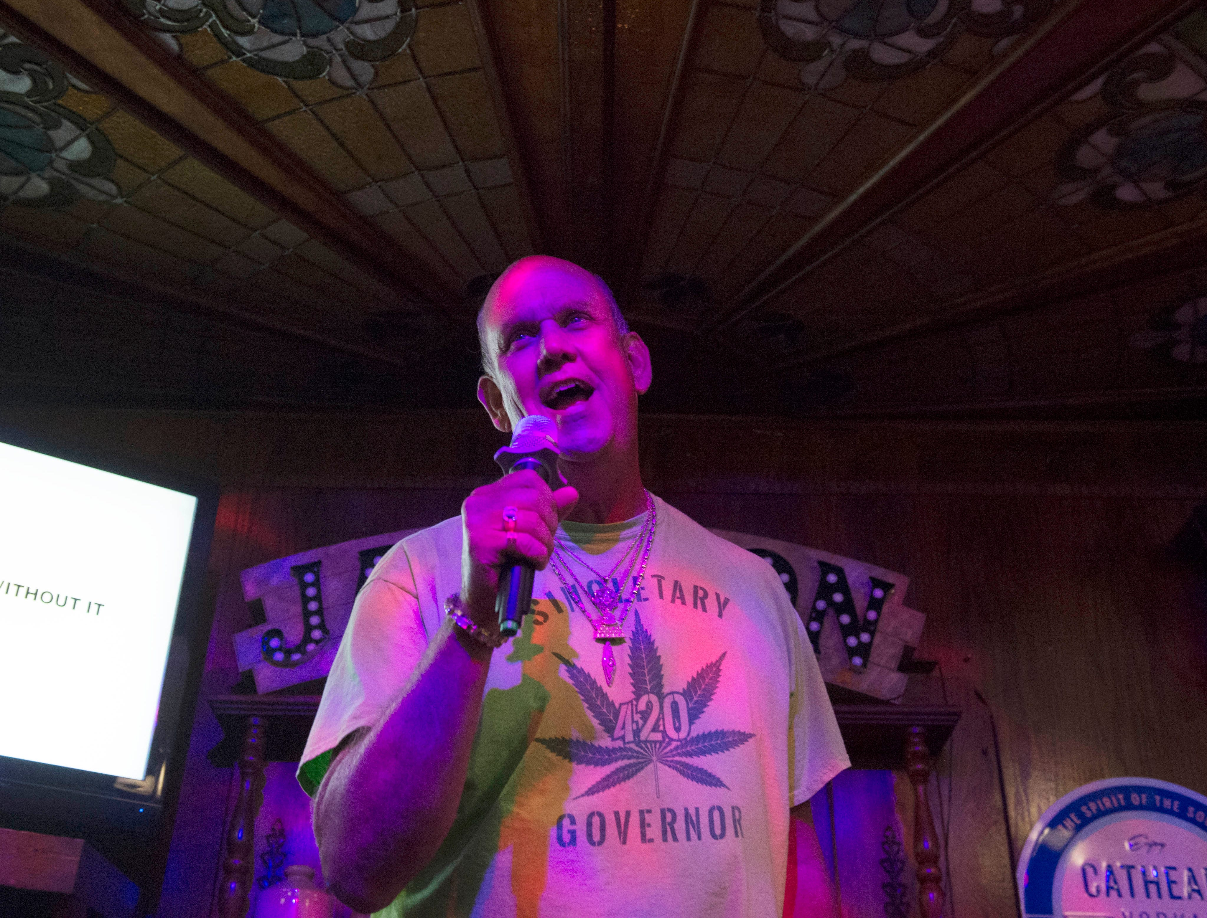 Mississippi 2019 independent gubernatorial candidate David Singletary performs during karaoke night at Fenian's Pub in the Belhaven Heights neighborhood of Jackson, Miss. on Monday night. Singletary's campaign platform is primarily based around legalization of Marijuana in Mississippi. Monday, April 30, 2019.