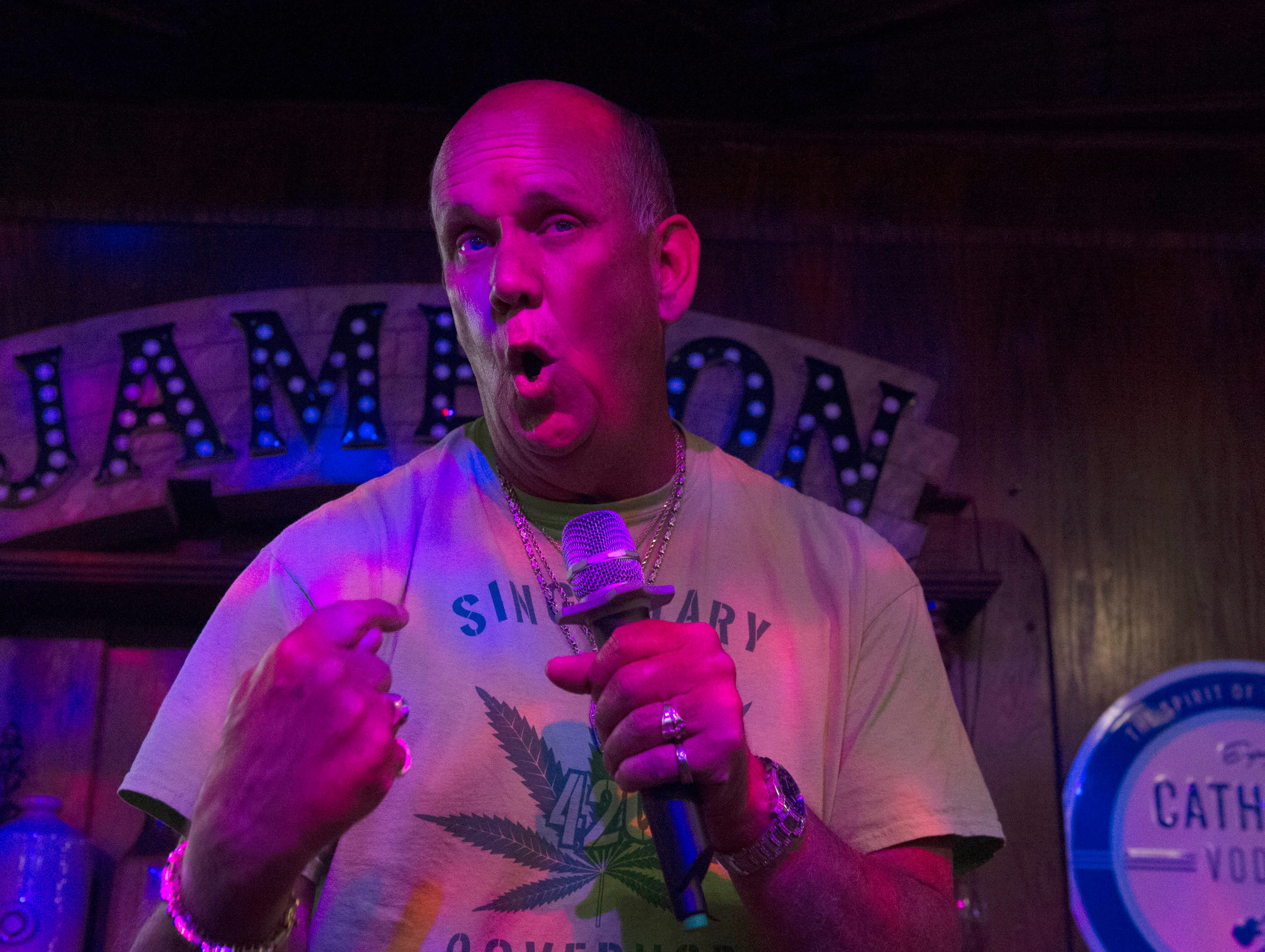 Mississippi 2019 independent gubernatorial candidate David Singletary performs singer Billy Idol's 'Rebel Yell' during karaoke night at Fenian's Pub in the Belhaven Heights neighborhood of Jackson, Miss. on Monday night. Singletary's campaign platform is primarily based around legalization of Marijuana in Mississippi. Monday, April 30, 2019.
