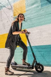 Black and teal VeoRide scooters, like the one pictured here, will hit Knoxville streets May 1 —  the same day the orange Spin scooters make their return.