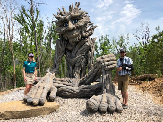 The Willow Man sculpture at Anakeesta was unveiled April 30, 2019. It's flanked by Anakeesta owner Karen Bentz and Project Manager Bryce Bentz.