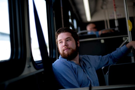 Knox News urban life writer Ryan Wilusz rides a Knoxville Area Transit bus in Knoxville, Tennessee on Tuesday, April 30, 2019.