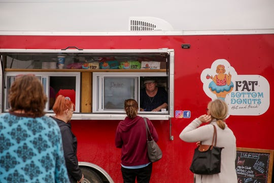 Carla Kaelin takes orders from customers in the Fat Bottom Donuts food truck, Monday, April 29, 2019 in Crawfordsville.