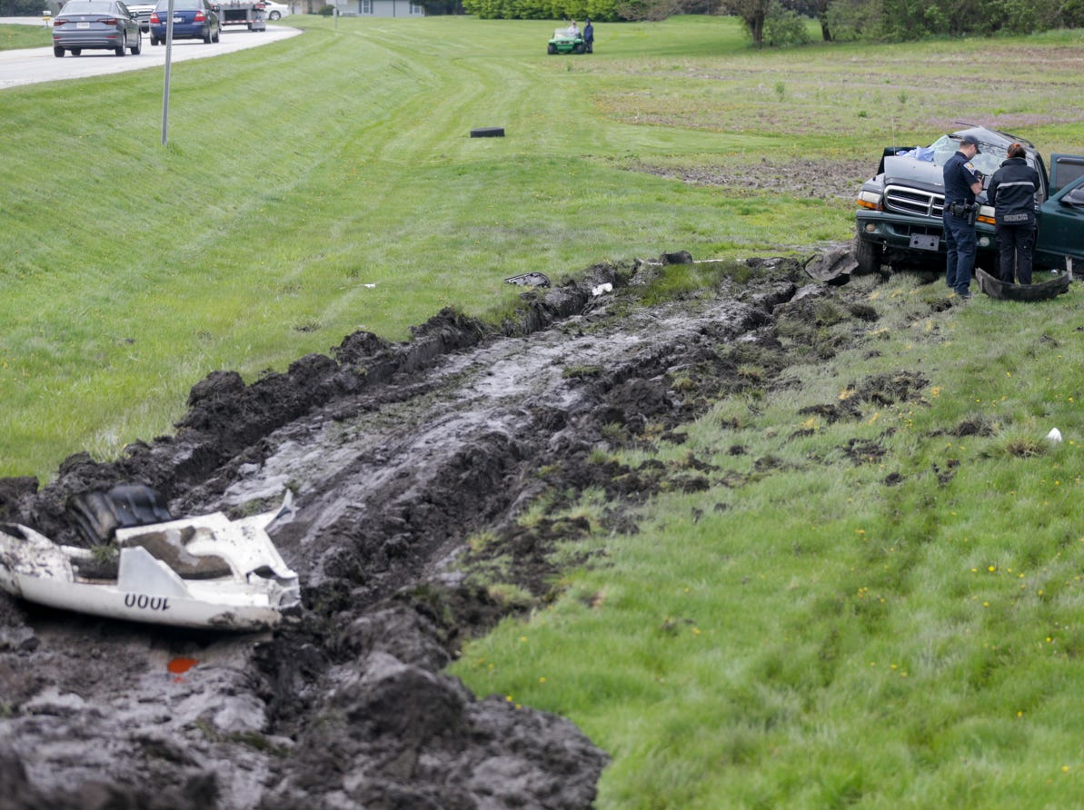 Drag marks from a semi-truck are seen in the mud as emergency crews work the scene of a fatal crash at the intersection of State road 26 E. and 900 E., Tuesday, April 30, 2019 in Lafayette. The passenger of the Dodge Durango was pronounced dead at the scene, according to the Tippecanoe County Sheriff's office. The driver of the Dodge was transported to IU Health Arnett Hospital in Lafayette, but was then transported by medical helicopter to a hospital in Indianapolis. The driver of the semi-truck was not injured in the crash.