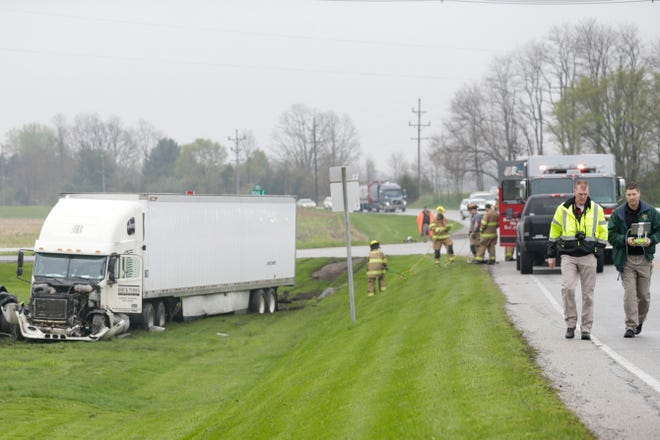 Emergency crews work the scene of a fatal crash at the intersection of State road 26 E. and 900 E., Tuesday, April 30, 2019 in Lafayette. The passenger of the Dodge Durango was pronounced dead at the scene, according to the Tippecanoe County Sheriff's office. The driver of the Dodge was transported to IU Health Arnett Hospital in Lafayette, but was then transported by medical helicopter to a hospital in Indianapolis. The driver of the semi-truck was not injured in the crash.