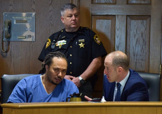 Rashad Martin reviews his case with attorney Roger Soroka on Tuesday in the Fairfield County Common Pleas Court.