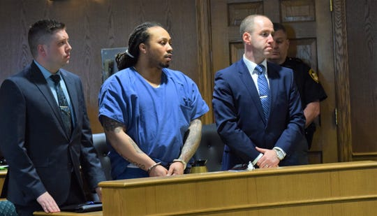 Rashad Martin, center, stands with his attorneys as he awaits sentencing in Fairfield County Common Pleas Court Tuesday morning.