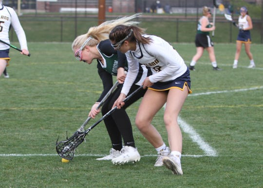Elena Salazar (foreground) scored six goals and one assist for Hartland against Novi.