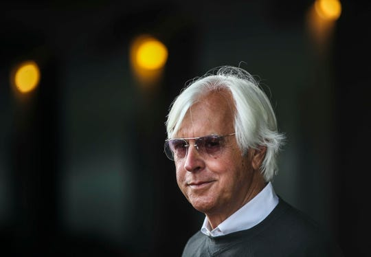 "Trainer Bob Baffert outside his barn at the Churchill Downs backside. ""It doesn't matter if they're running a burro,"" rival trainer D. Wayne Lukas said. ""They say, 'Well, here's Baffert. He wins races.' So they bet."" Baffert has Game Winner, Improbable and Roadster in the 2019 Kentucky Derby. April 30, 2019"