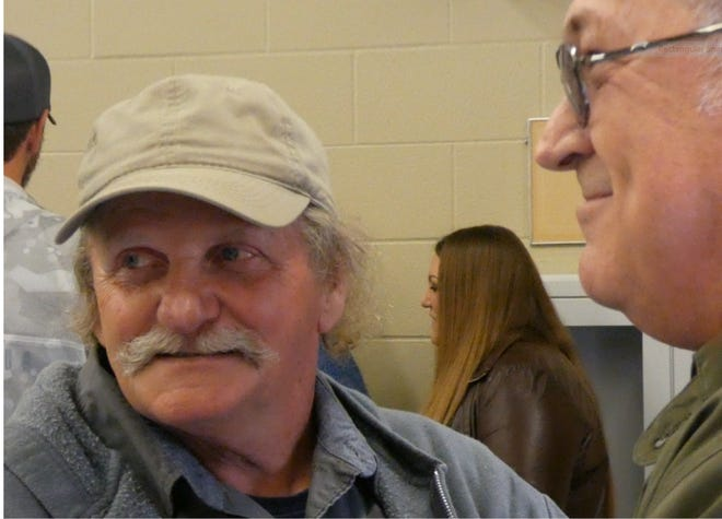 Danny Mapes, who retired Tuesday with the City of Mansfield Sewer Department, is congratulated by Ron Davis.
