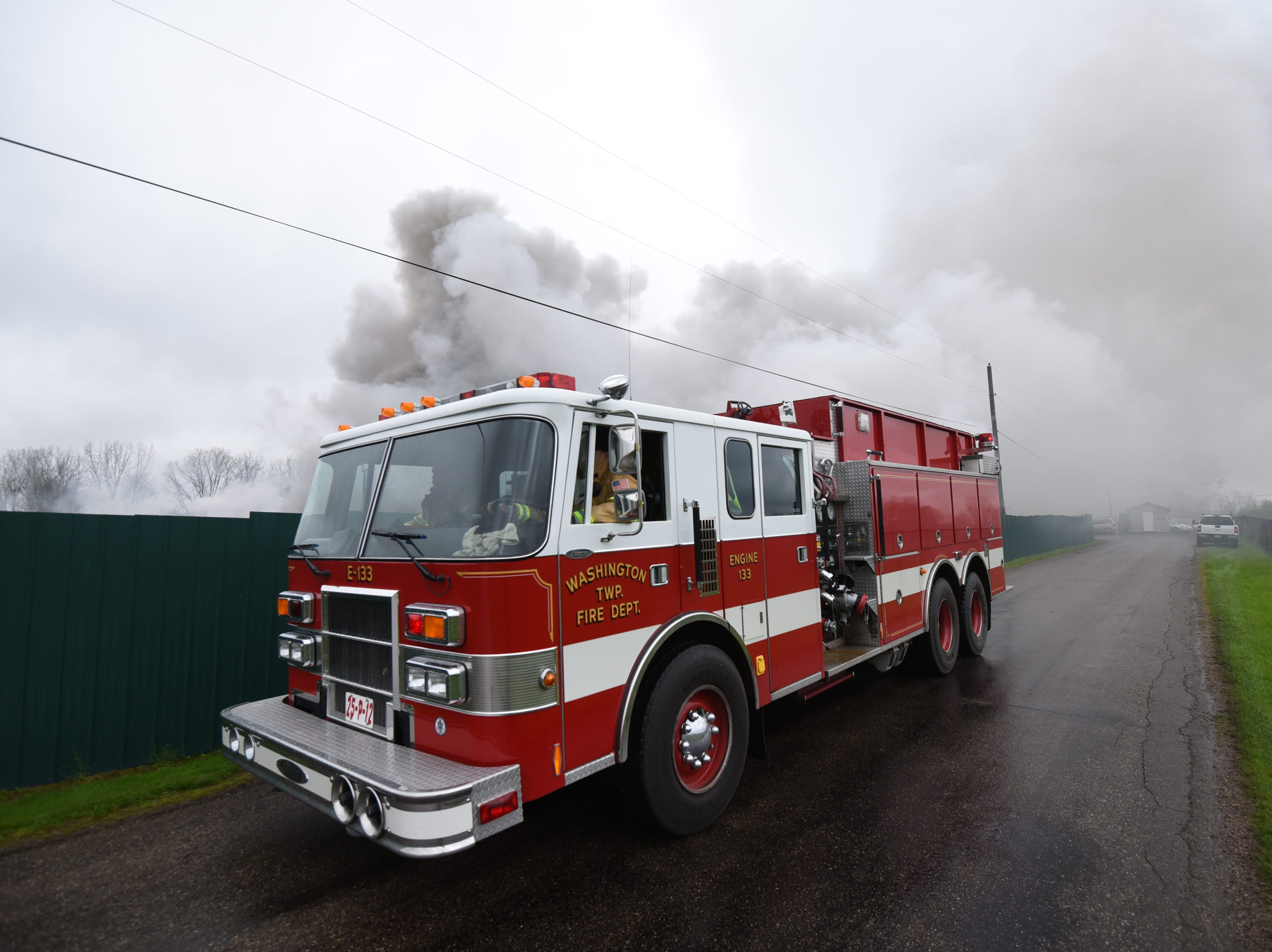Firefighters battle a blaze Tuesday afternoon at Tucker Brothers Auto Wrecking on Hickory Lane.