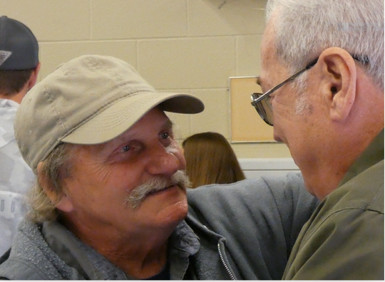 Danny Mapes and Ron Davis, fellow union men, reminisce about days goneby during Mapes' retirement/farewell luncheon at North Lake Park Tuesday. He retired from the city sewer department after 26.5 years.