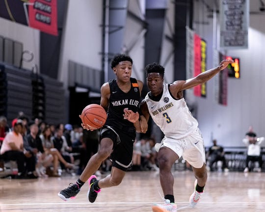 Mokan Elite guard Kennedy Chandler drives to the basket against Boo Williams at the first Nike EYBL session in Atlanta on April 27, 2019.