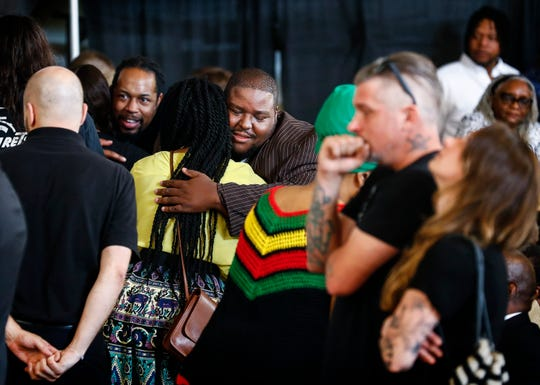 Joe Higgins (middle) hugs friends while attend a funeral for his brother Omar Higgins, the bassist and leader of reggae band Chinese Connection Dub Embassy and hardcore punk band Negro Terror, at Clayborn Temple Tuesday, April 30, 2019.