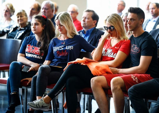 Children of the late Ole Miss basketball great Johnny Neumann, (left to right) Esmeralda Neumann, Maria Eleni Neumann, Leslie Neumann and Sam Neumann remember their father during a memorial service inside The Pavilion on campus Monday, April 29, 2019 in Oxford, Miss.