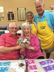 JCMI big winners Helen Kocoras and Eddie Sadiwski with Bingo committee members Jonathan and Heather Greenfield.