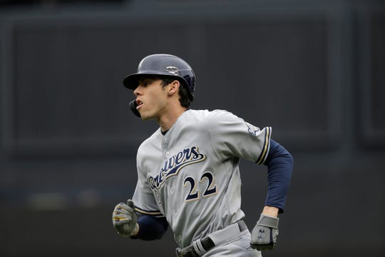Christian Yelich has suffered discomfort since tweaking his back on the base paths Sunday.