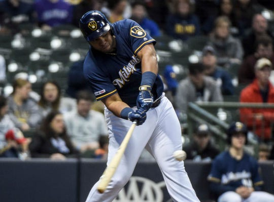 Brewers first baseman Jesus Aguilar hits a three-run homer in the first inning Monday night.