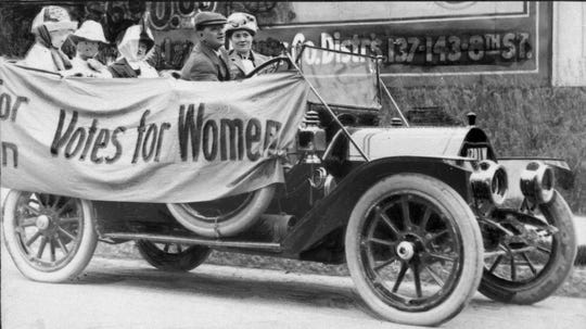 "Members of the Political Equality League are pictured in Milwaukee in an automobile draped with bunting reading ""Votes for Women.""  Despite numerous attempts to grant Wisconsin women full voting rights over several decades, the state lagged behind many others until Congress passed the 19th Amendment. Wisconsin was the first state to ratify the amendment."