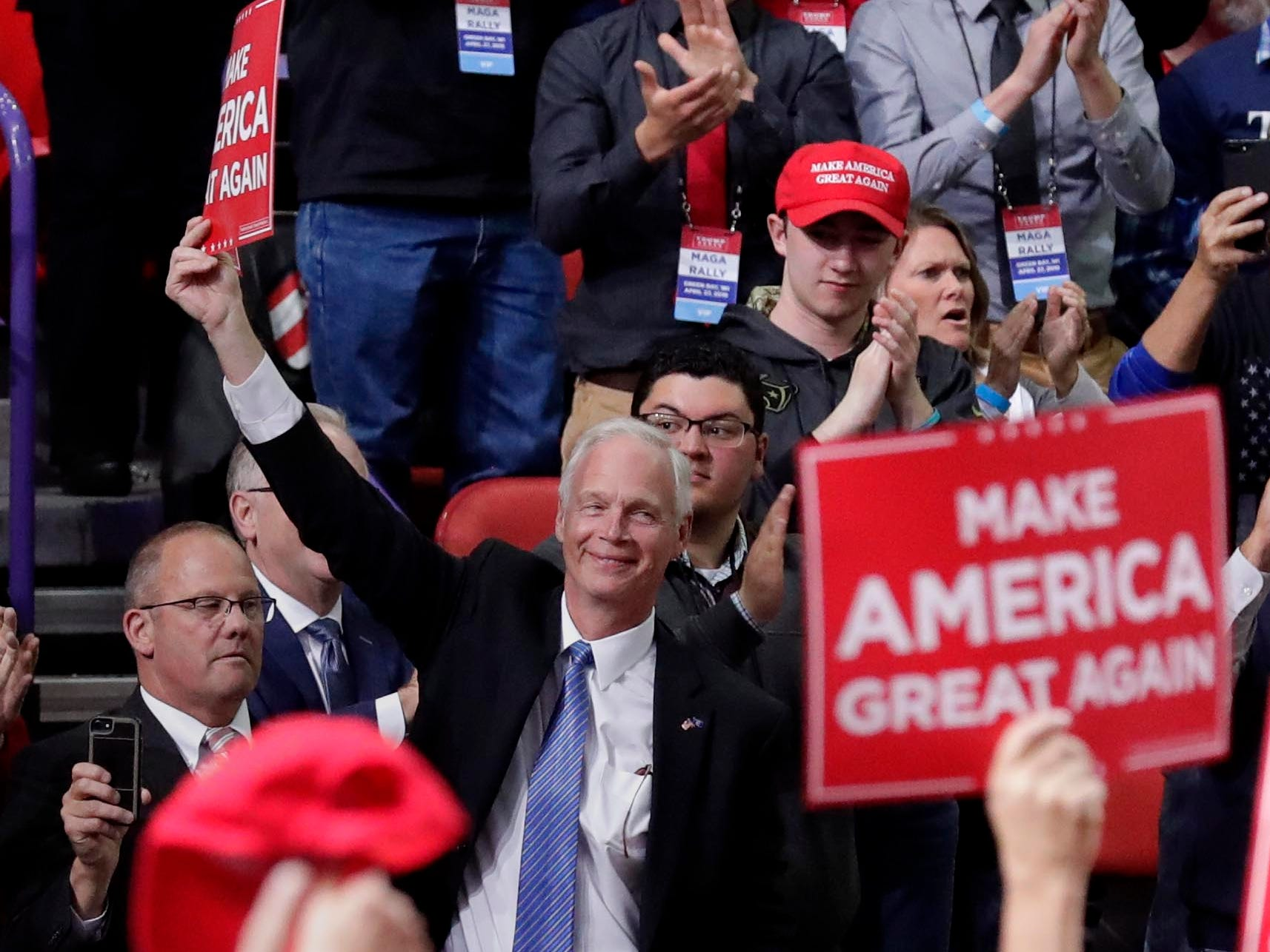 Wisconsin Senator Ron Johnson greets the crowd when introduced by President Donald Trump as he delivers a speech to supporters in Green Bay.