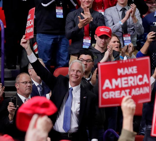Wisconsin Sen. Ron Johnson greets the crowd when introduced by President Donald Trump at a rally Saturday in Green Bay.