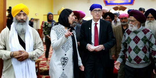 Wisconsin Gov. Tony Evers, center, tours the Sikh Temple of Wisconsin on Tuesday.  The governor presented the Sikh Temple with a resolution marking April as Sikh Awareness & Appreciation Month.