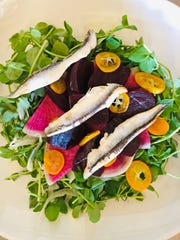 This beet and white anchovy salad from Bavette shows ingredients artfully arranged for presentation — no extra garnish needed.