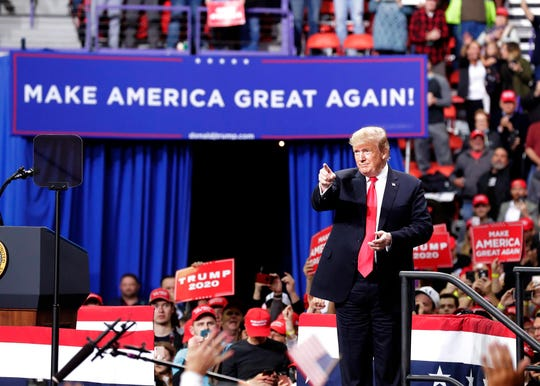 President Donald Trump receives cheers from the crowd as he delivers a speech to supporters April 27 at the Resch Center.