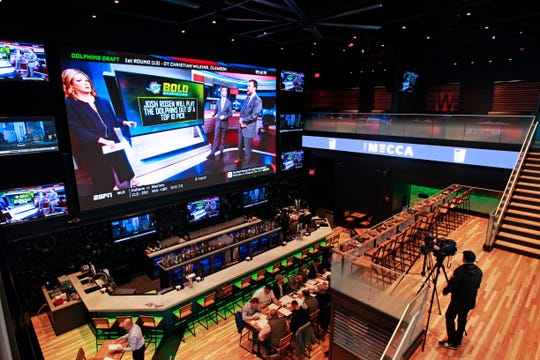 This 38-foot television monitor is the featured piece at The Mecca Sports Bar and Grill at the Fiserv Forum plaza. The Mecca is the last major business to open in this portion of the Deer District, the area surrounding the new arena.