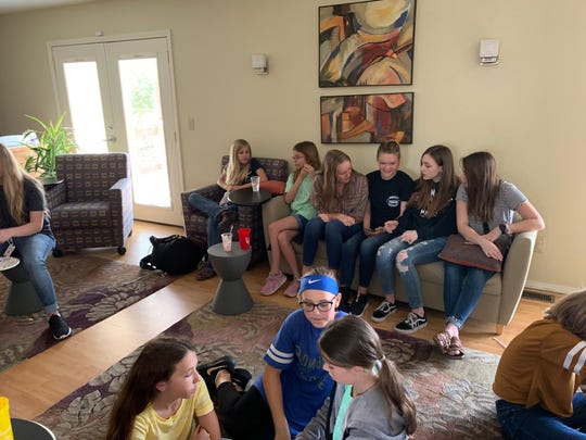 Preteens in the BigLil program meet with their Mountain Home High School mentors during a recent meeting.